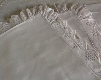 Pair of French white cotton pillowcases with broderie anglaise.