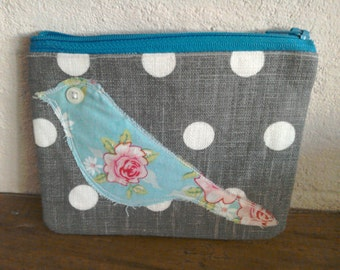 Grey Spotted purse with bird detail.