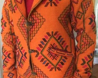 Hand woven yathra (sheep wool) over coat from Bhutan