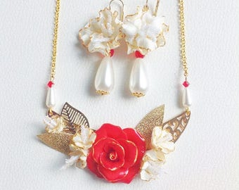 Red, white and gold set with cold porcelain flowers