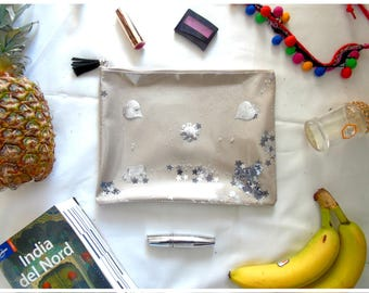 Magic clutch bag with glitter and elements to shake