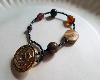 Beaded bracelet with button closure, 7 1/2 inches, brown, blue, purple