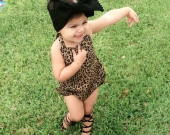 Cheetah print baby romper with snap buttons for easy diaper change.
