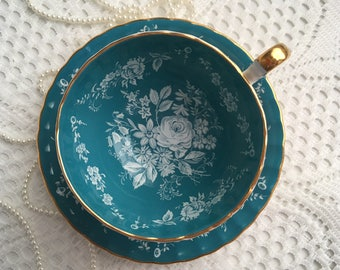 Reserved Aynsley China Tea Cup and Saucer, Blue with Hand Painted White Floral Centres and Gold Trim