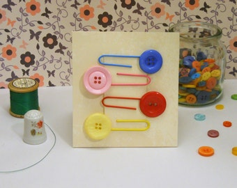 Set of four button paperclip bookmarks