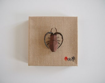 Origami insect artwork