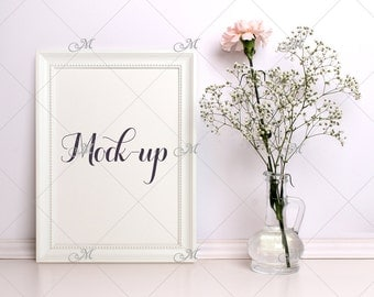 White Frame Mockup with Carnation. PSD, Smart object.