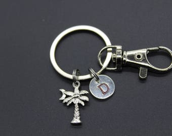 Palm tree with crescent moon and initial charm on a key chain