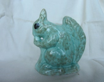Vintage squirrel figurine, English mid century pottery ornament in green. Countryside nature wildlife animal