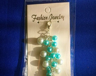Pale and light blue and silver bag, keyring, zipper charm