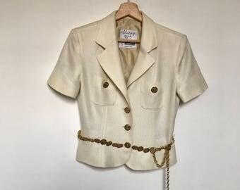 Giacca Moschino cheap and Chic vintage beige con bottoni e decoro in vita con monete logate dorate