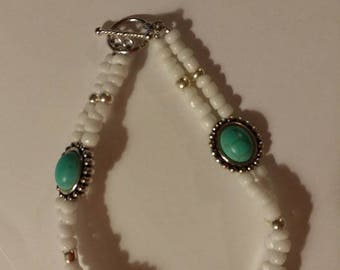 Teal and silver Bracelets with white beads