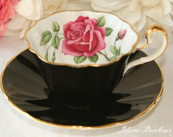 Adderley, England: Elegant black tea cup and saucer with a large red rose