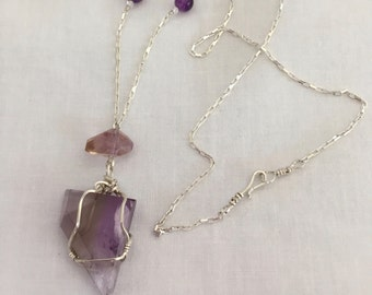 Amethyst necklace, beautiful.  Elegant enough to wear on a night out or with jeans.
