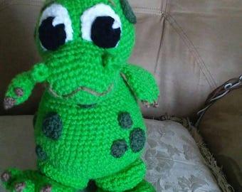 Handmade crocheted green dinosaur