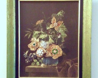 Framed floral vintage print embellished with antique jewelry and FOE butterfly pin