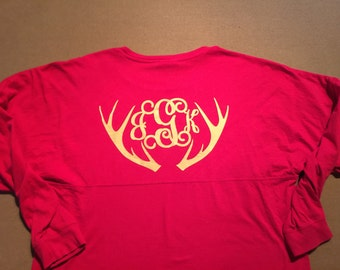 Deer horns with monogram initals on spirit jerey long sleeve shirt.