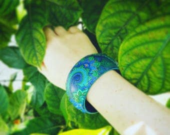 Wooden handpainted bangle with blue & green mehndi patterns.