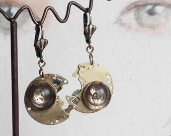 Steampunk Earrings made of  bronze colour pieces of  watch and a  resin cab with gears inclusions