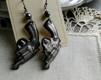 Toy gun earrings-  up cycled earrings made from vintage 60s tin toy gun badges