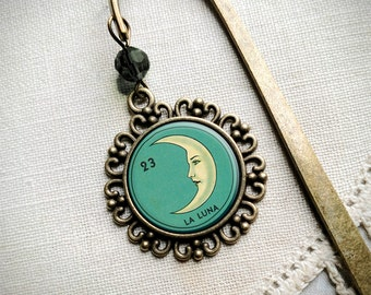 La Luna brass book hook bookmark with dangling glass cabochon accent