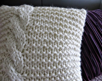 Knitted cushion with braid