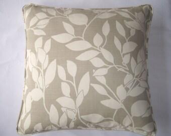 Cream and taupe leaf design cushion cover.