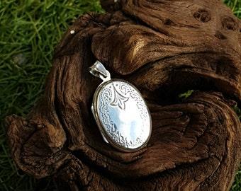 Vintage oval silver locket