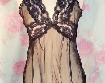 Black lace and sheer camisole or shorty