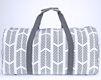 Gray and white Arrows duffle bag