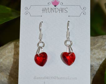 These earring's are a red glass heart,with a extra loop on a silver plated earring hook!