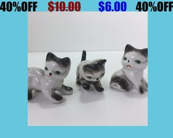 Three Small Cat Figurines