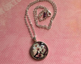 Metal necklace silver with cabochon cherry blossoms