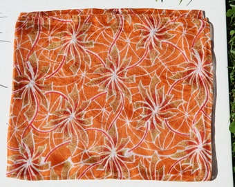 Silk stole,  scarf or paréo in soft orange colour.