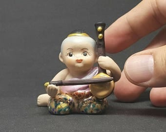 Thai ceramic doll for Miniature Collectible Doll of Vintage Toy or Home Decorate Porcelain Doll