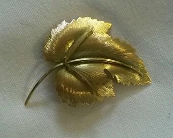 Vintage gold metal leaf brooch