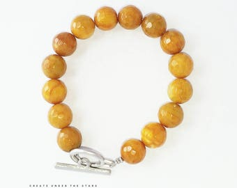 Mustard gemstone bracelets.