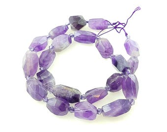A Strand of Semi-precious Amethyst Faceted Nuggets. Approx 15mm by 12mm