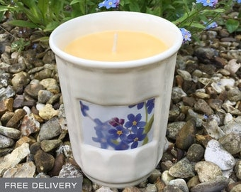 Handmade forget me not scented candle with reusable pottery jar.