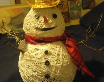 Hand made thread snowman with straw cowboy hat