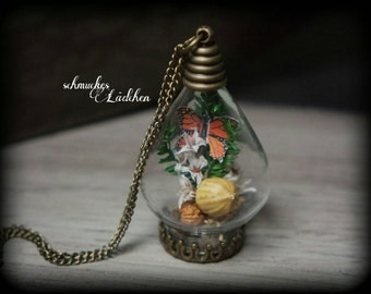 Antique bronze glass vials necklace with real flowers and Butterfly