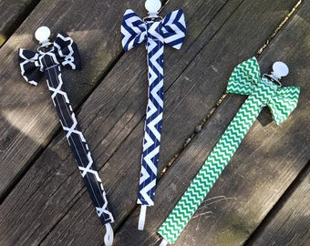Boy or girl pacifier clip with bow tie