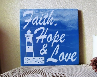 Sign that says, Faith, Hope & Love w/Lighthouse, Marked Down,,,Beautiful Blue Beach Style Plaque...Aprox. 9'' x 9'', Makes a Great Gift!