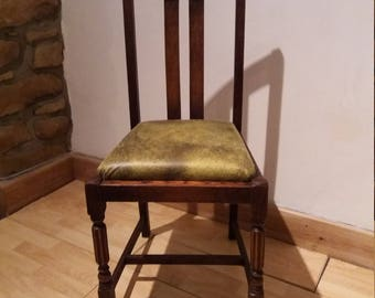 Up cycled distressed dining chair