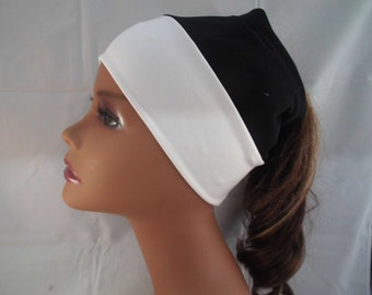 Black and white beanie with hole in top ponytail, natural hair or braids, ponytail opening