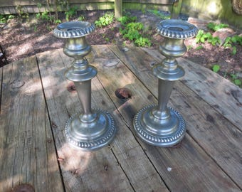 Pair of ornate vintage french pewter candle sticks