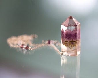 Transparent crystal shaped pendant with the real purple flower inside