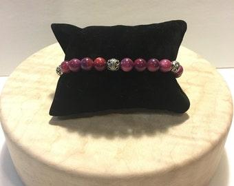 Purple swirl bead bracelet