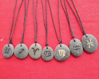 Stone beach with engraving zodiac sign