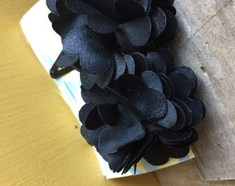 Black satin flower hairclips.